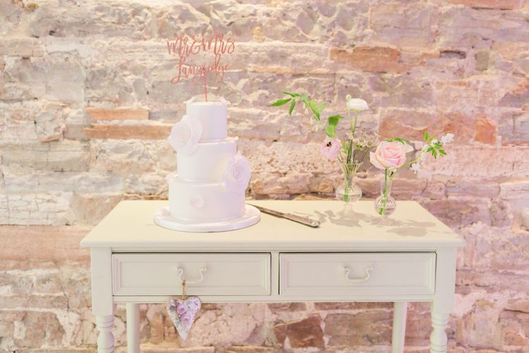 Pastel Cake Table With Glitter Cake Topper // Almonry Barn Somerset Wedding With Bridesmaids In Pale Pink Mori Lee Dresses And Bride In BHLDN With Images From Bowtie And Belle Photography