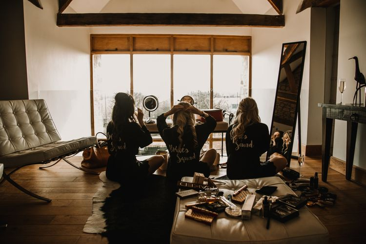 Bridesmaids Getting Ready on Wedding Morning in Brides Squad Getting Ready Robes