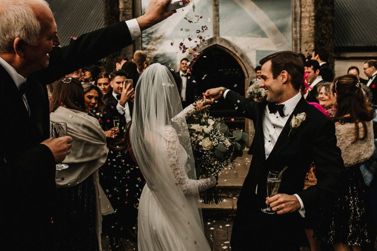 Confetti Moment with Bride in Made With Love Bridal Wedding Dress and Groom in Tuxedo