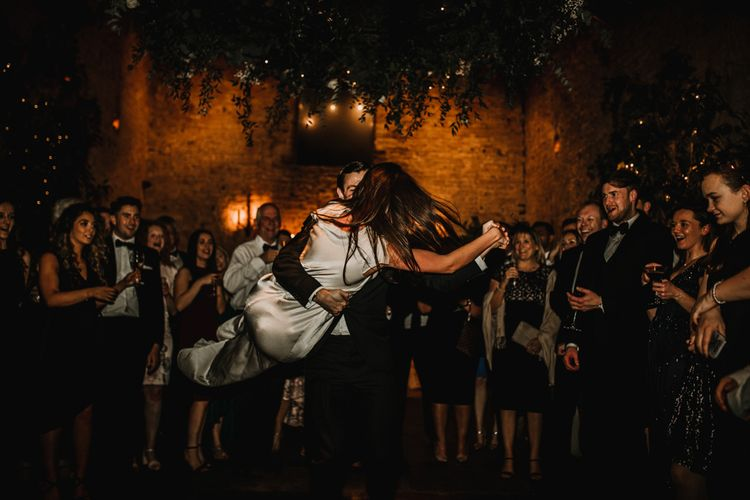 First Dance with Groom Twirling His Bride Around
