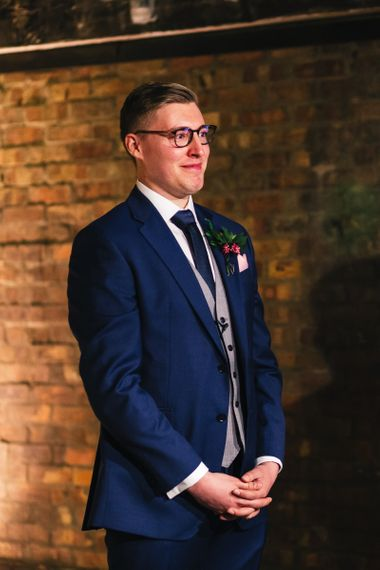 Groom in Glasses in Navy Charles Tyrwhitt Suit with Grey Waistcoat
