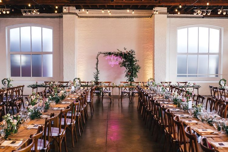 Wedding Reception Decor at Trinity Buoy Wharf with Neon Wedding Sign Top Table Backdrop