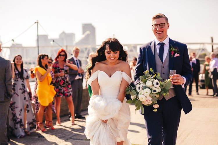 Bride in Martina Liana Chiffon Wedding Dress with Bardot Sleeves and Groom in Navy Charles Tyrwhitt Suit