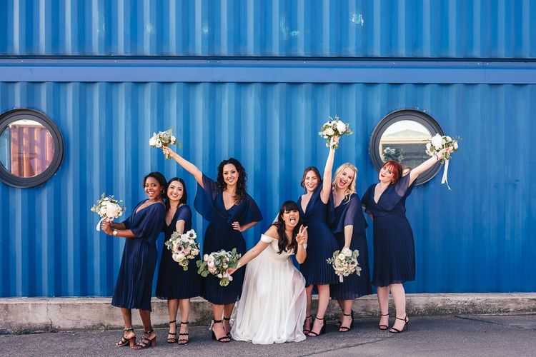 Bridal Party Portrait with Bridesmaids in Navy Dresses and Bride in Martina Liana Chiffon Wedding Dress