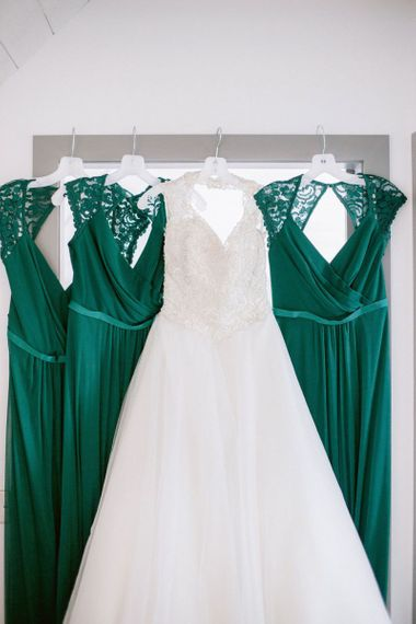 Green bridesmaid dresses hung up before Barra Castle wedding