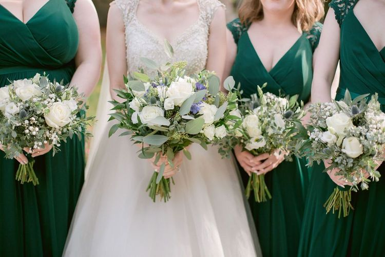 White wedding bouquet for green bridesmaid dresses