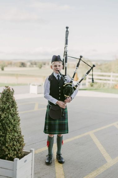 Bagpipe player at Scottish wedding at Barra Castle