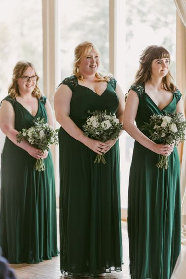 Green bridesmaid dresses with white bouquets