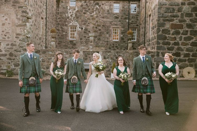 Wedding party in green kilts and bridesmaid dresses