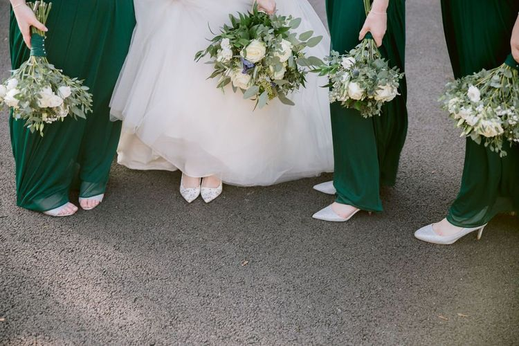 Green bridesmaid dress with white bouquet