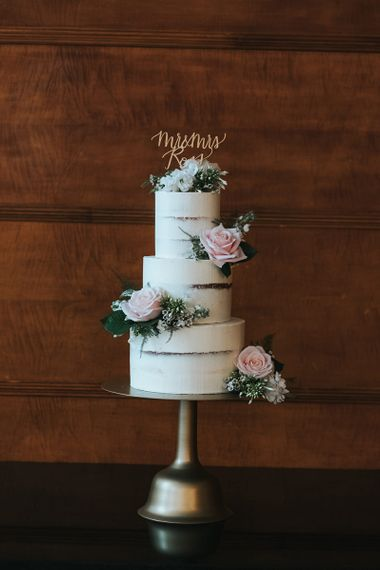 Three-Tier Semi-Naked Wedding Cake on Gold Stand with Fresh Flowers | Gold Calligraphy Cake Topper | Statement Floral Arrangement Altar and Potted Plants with Copper Frame Table Plan and Lace Jacket | Miss Gen Photography