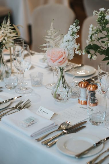 Blush Roses and Foliage in Bud Vases | Papier Place Cards | Mint Box Favours | Statement Floral Arrangement Altar and Potted Plants with Copper Frame Table Plan and Lace Jacket | Miss Gen Photography