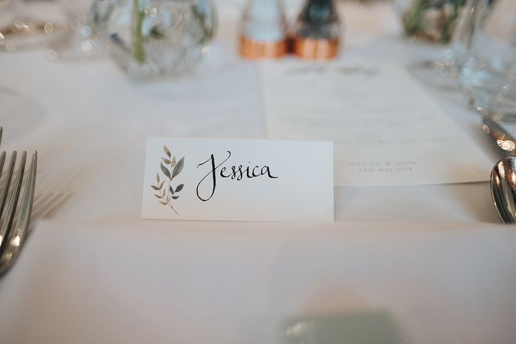 Papier Place Cards | Statement Floral Arrangement Altar and Potted Plants with Copper Frame Table Plan and Lace Jacket | Miss Gen Photography