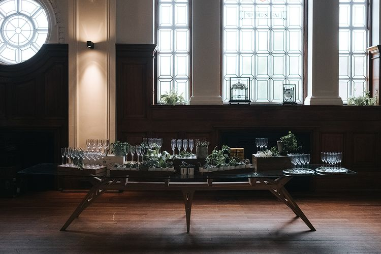 Champagne Table Decorated with Succulents and Wooden Crates | Wedding Reception at Town Hall Hotel | Statement Floral Arrangement Altar and Potted Plants with Copper Frame Table Plan and Lace Jacket | Miss Gen Photography