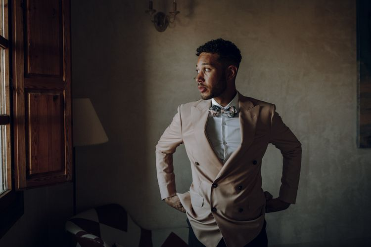 Groom in double breasted pale pink blazer