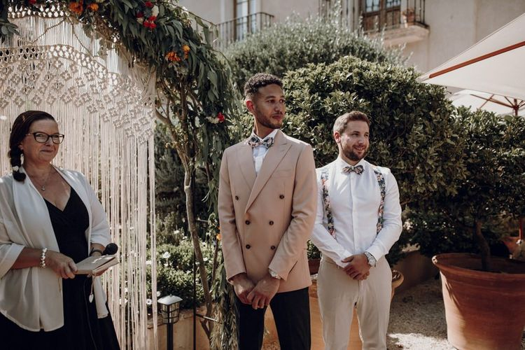 Groom standing at the altar in double breasted blazer
