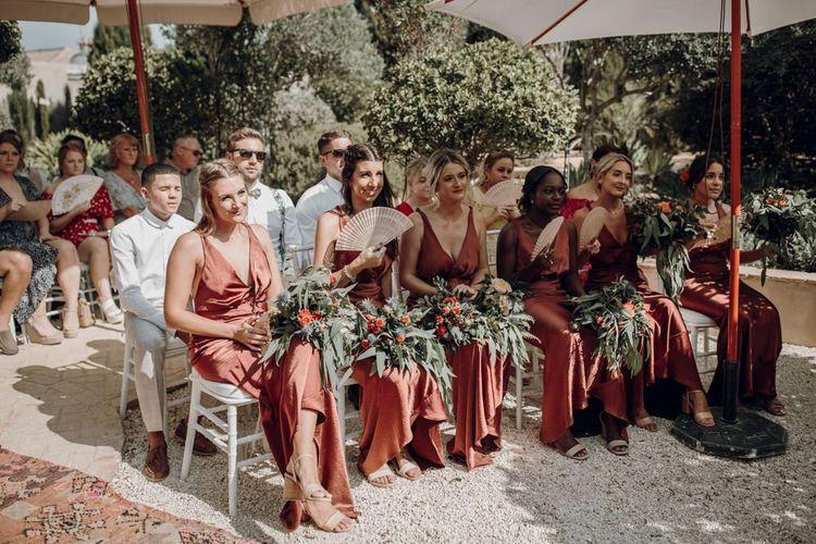 Bridesmaids in bronze satin dresses