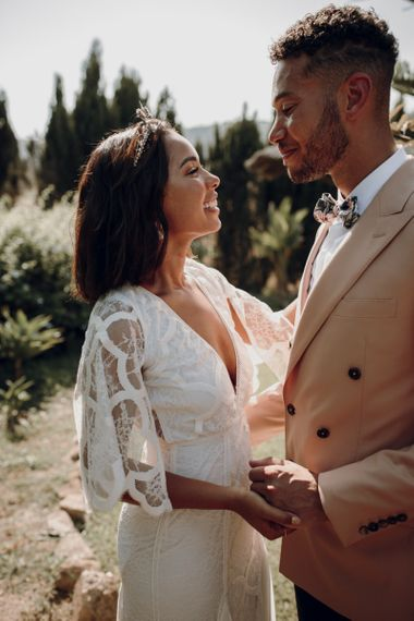 Intimate wedding portrait with bride in Grace Loves Lace dress