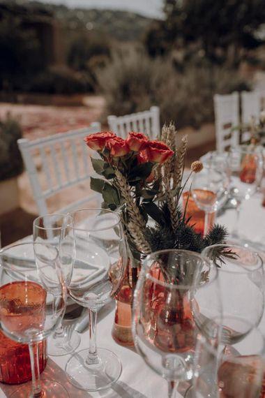 Orange goblets and flower table decor