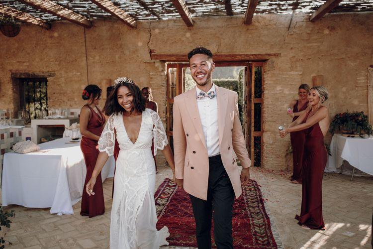 Bride and groom entering the outdoor wedding reception