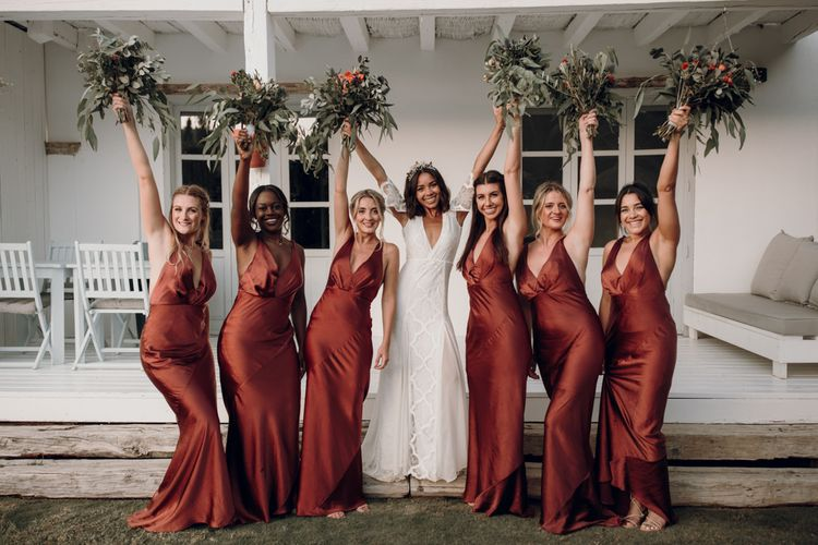 Bridal party portrait with bridesmaids in bronze satin dresses and bride in Grace Loves Lace