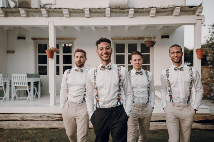 Groomsmen in floral braces and bow ties