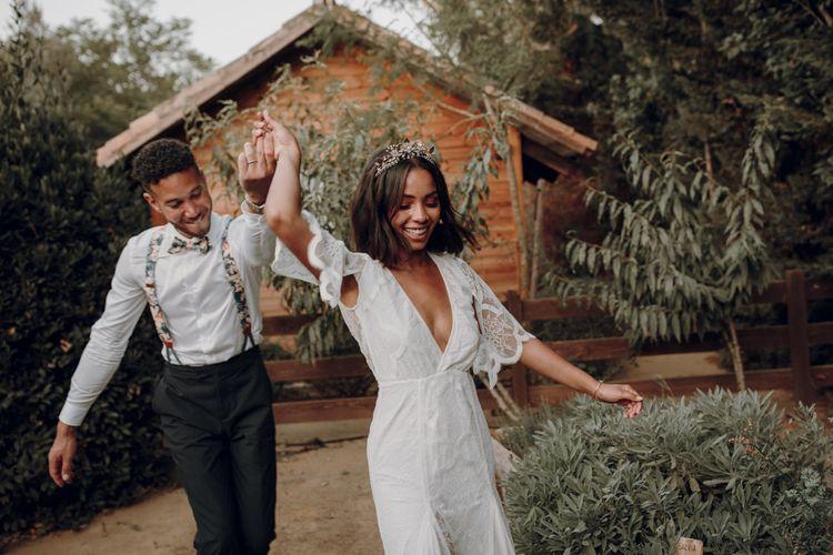 Boho bride and groom dancing