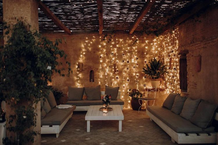Chill out area with string lights and polaroid pictures