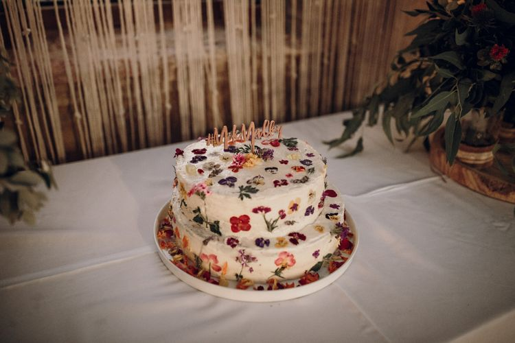 Edible flower cake table with wooden cake topper