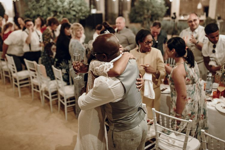 Bride embracing her father at the wedding reception