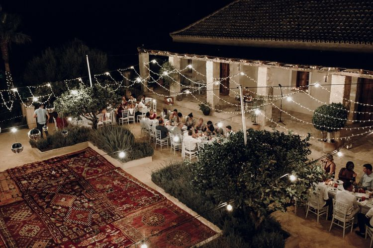 Outdoor wedding reception at Casa la Siesta with rugs and fairy lights decor