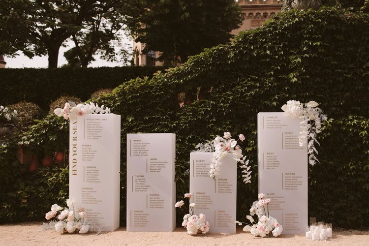 Beautiful wedding table seating plan with flower decor