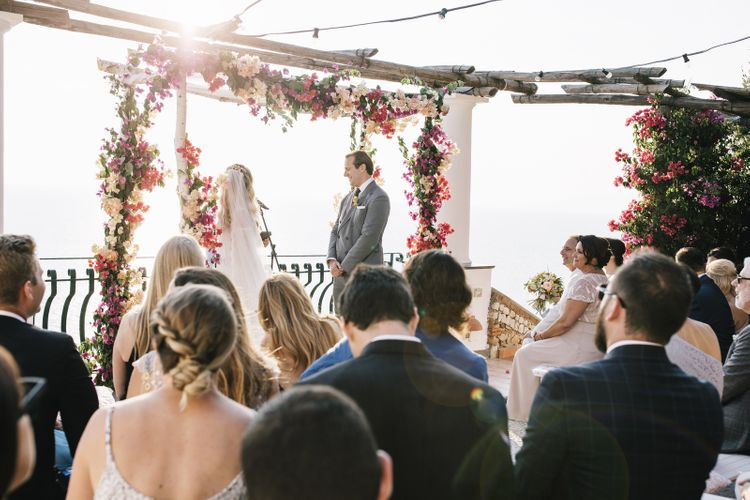 Costal Capri Wedding Ceremony with Altar Covered in Pink Flowers