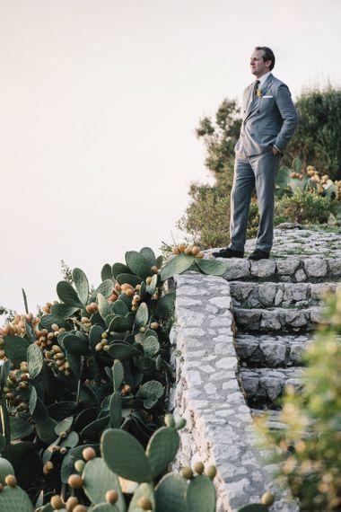Groom in Grey Ralph Lauren Suit
