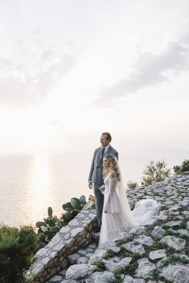 Boho Bride in Bardot Tulle and Lace Flora Bridal Wedding Dress and Groom in Grey Ralph Lauren Suit