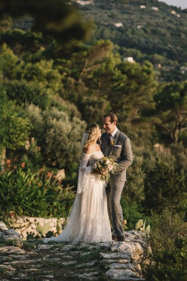 Bride in Bardot Tulle and Lace Flora Bridal Wedding Dress and Groom in Grey Ralph Lauren Suit