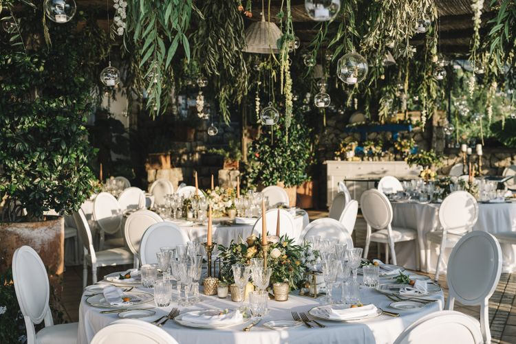 Outdoor Wedding Reception Decor with Peach Flowers and Foliage
