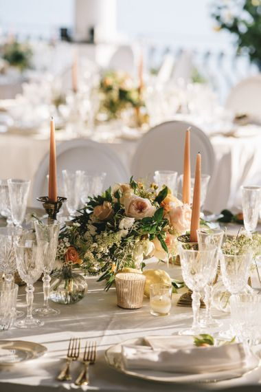 Low Floral Centrepiece and Coloured Taper Candles
