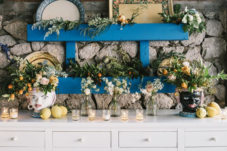Wedding Sideboard Decor with Floral Arrangements and  candles
