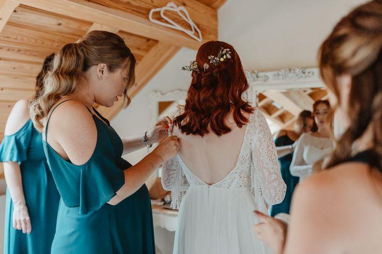Bridal Preparations with Bridesmaids Helping Bride Get Ready