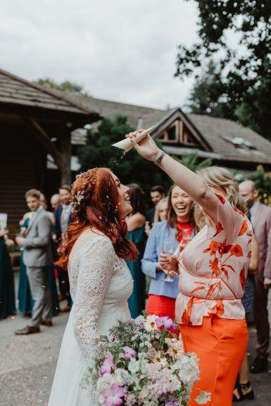 Guest Pours Leftover Confetti On Bride