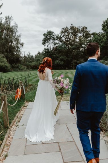 Bride In Lucy Can't Dance Wedding Dress Carrying Wildflower Bouquet