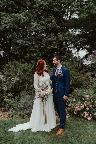 Bride and Groom Enjoy A Moment to Themselves  Before Reception