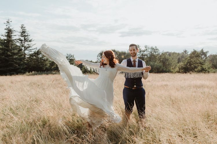 Bride Shows Off Fringed Detail On Arm Of Dress