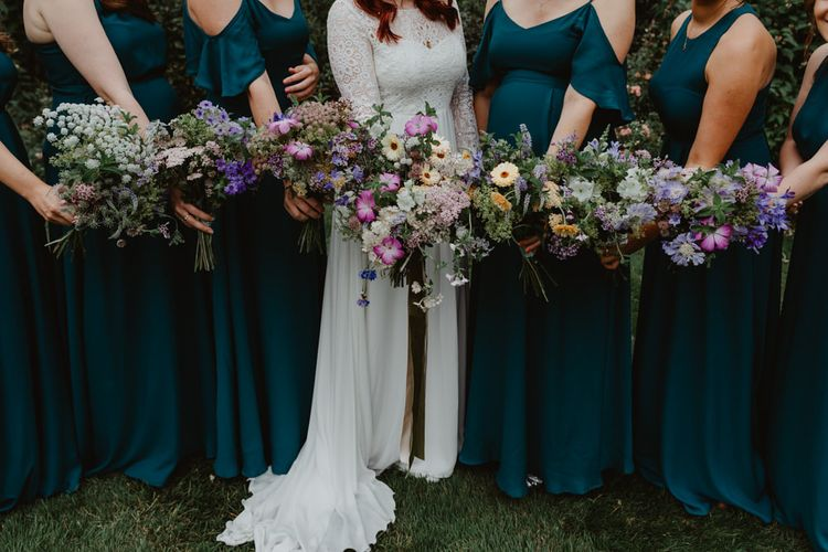 Rewritten Teal Bridesmaid Dresses With Wildflower Bouquets