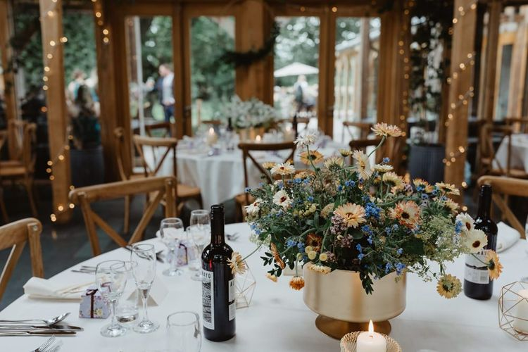 Rustic Wedding Venue  With Wildflowers Table Decoration