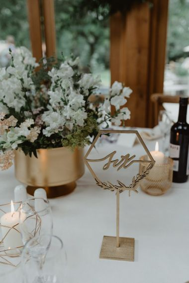 Gold Table Numbers and White Flowers in Gold Vase