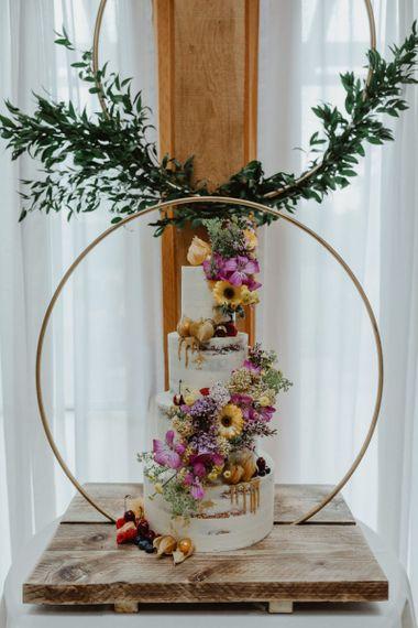 Wildflower Tiered Wedding Cake With Hoop Decor