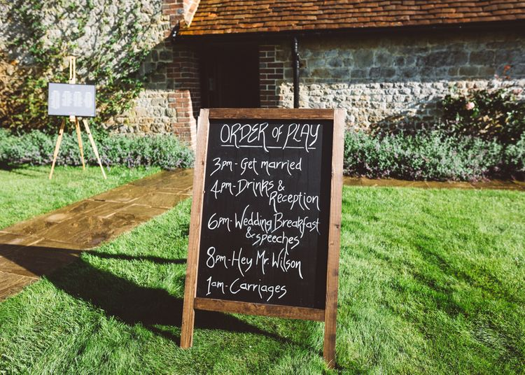 Chalkboard Sign For Wedding // Valeria By Pronovias Bridal For Elegant At Home Wedding With Clear Marquee And White Florals And Images From Holly Carlin Photography