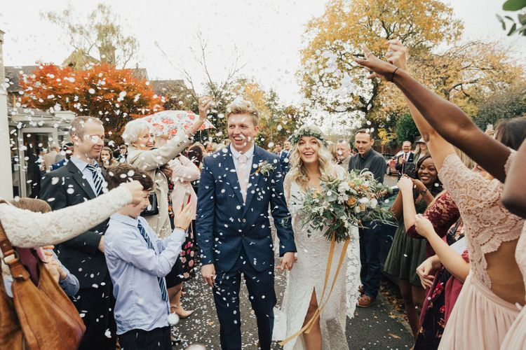 Confetti Moment with Bride in Boho Wedding Dress and Groom in Navy Suit